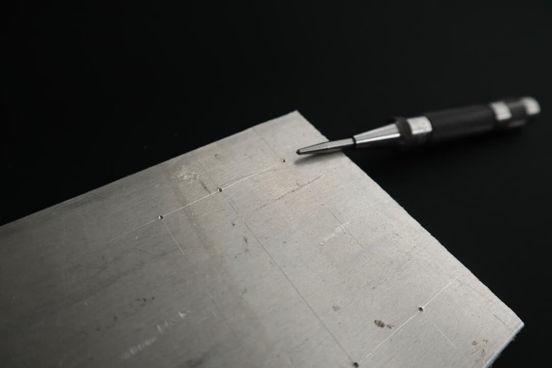 An automatic center punch and dimples