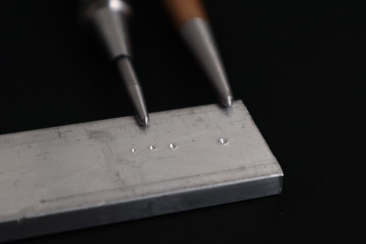 Dimples produced by an automatic center punch at different force settings