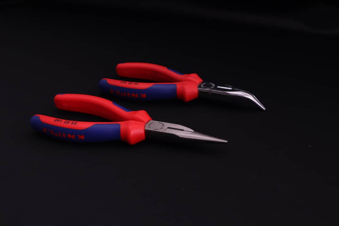 Angled or bent and straight versions of long nose pliers