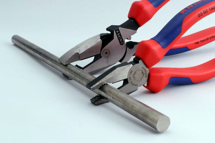 Combination pliers and Lineman's pliers gripping a smooth rod