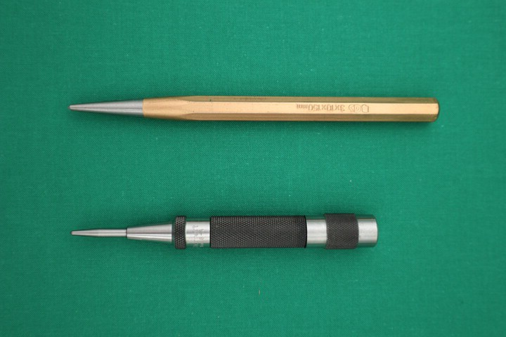 A manual and an automatic center punch
