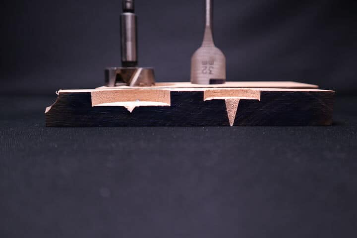 Cross section of holes drilled with a Forstner and a spade wood drill bit