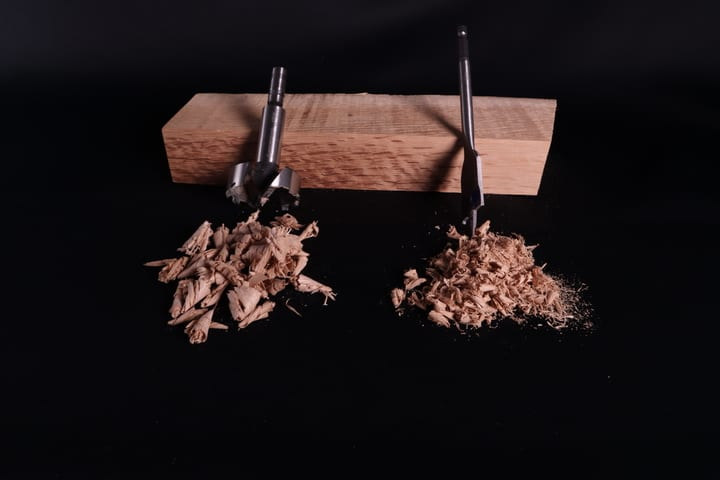 Shavings made by Forstner and spade drill bits