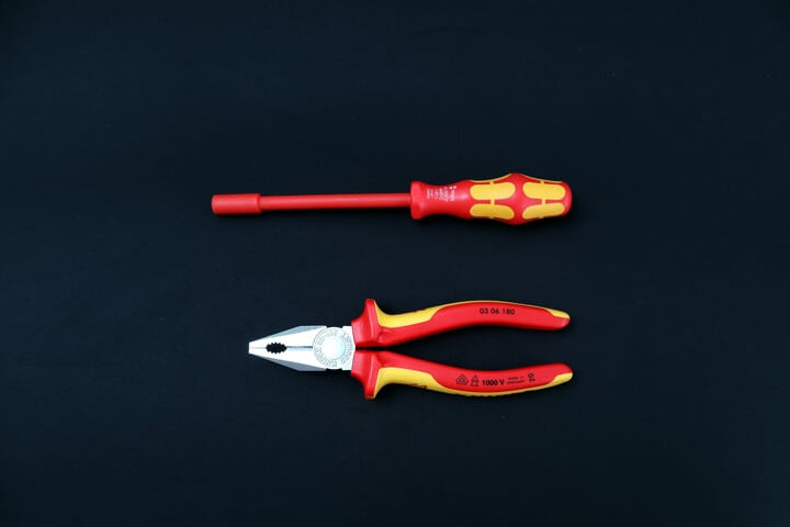 An insulated screwdriver and combination pliers