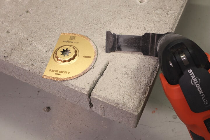Concrete slab cut with an oscillating multi-tool