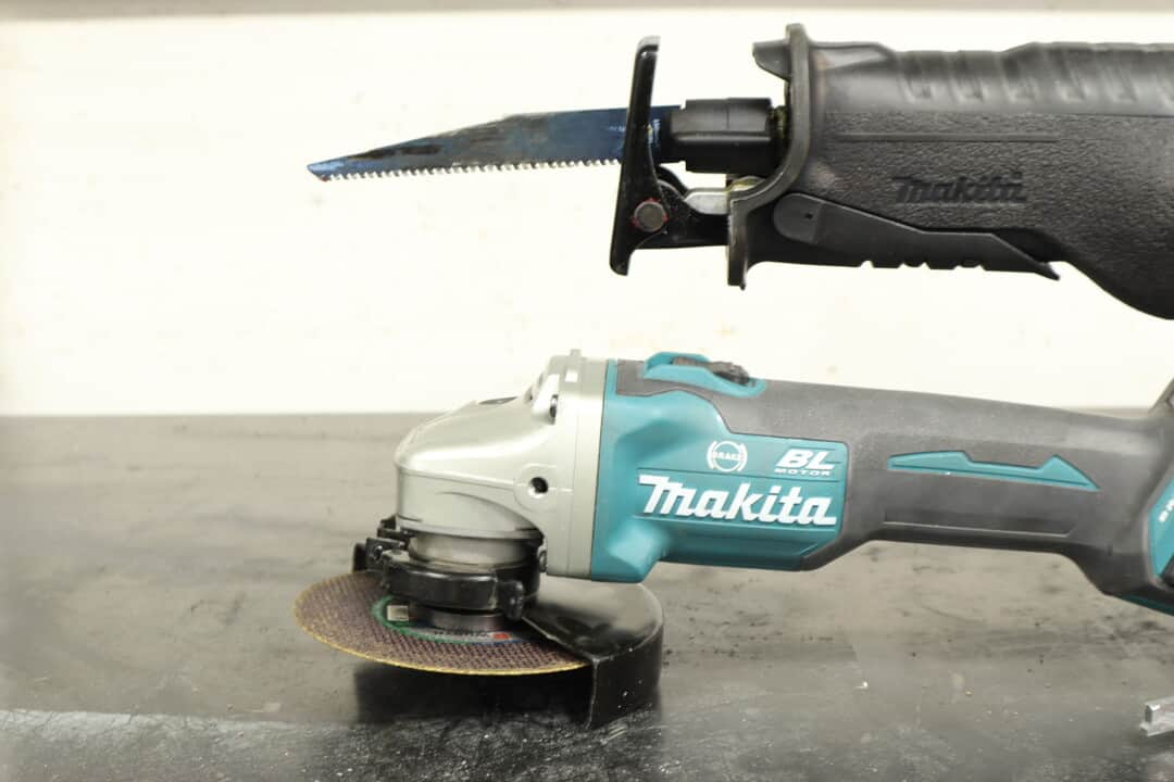 A reciprocating saw and an angle grinder